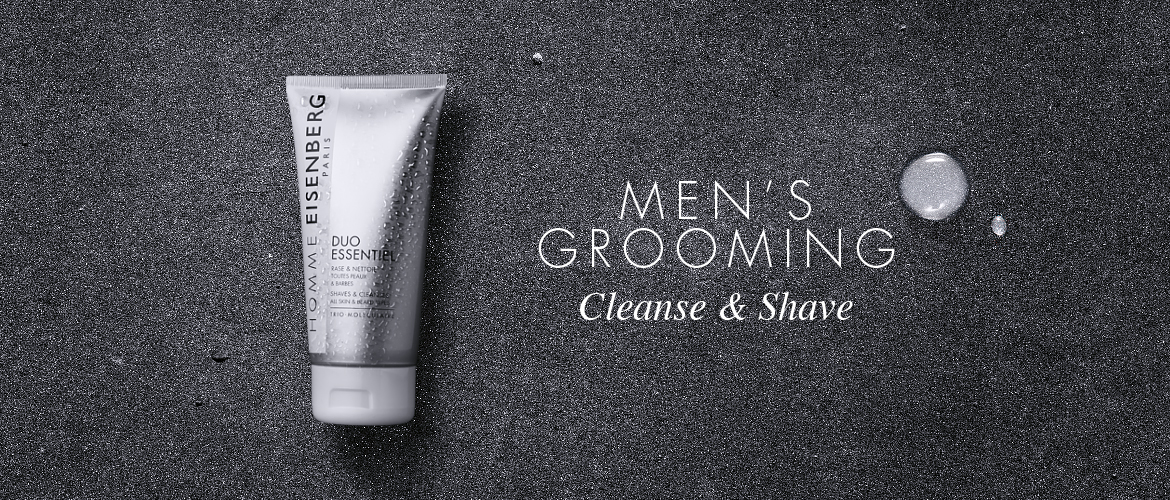 facial cleanser for men on a mirror and a grey chalk background