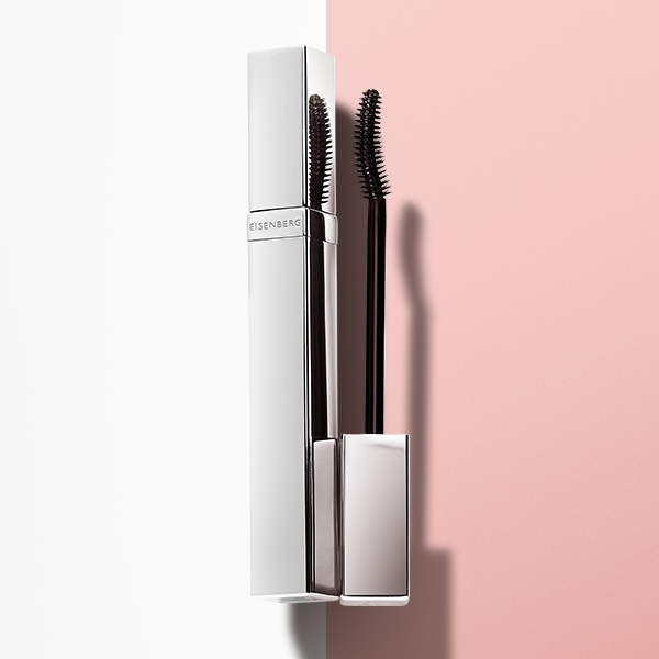 lash care mascara against a pink and white background
