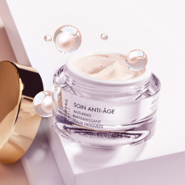 anti-wrinkle cream open with its golden tap and bubbles