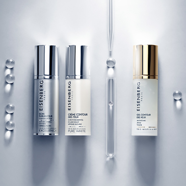 three targeted eye creams and a pipette aligned on a grey background with transparent bubbles
