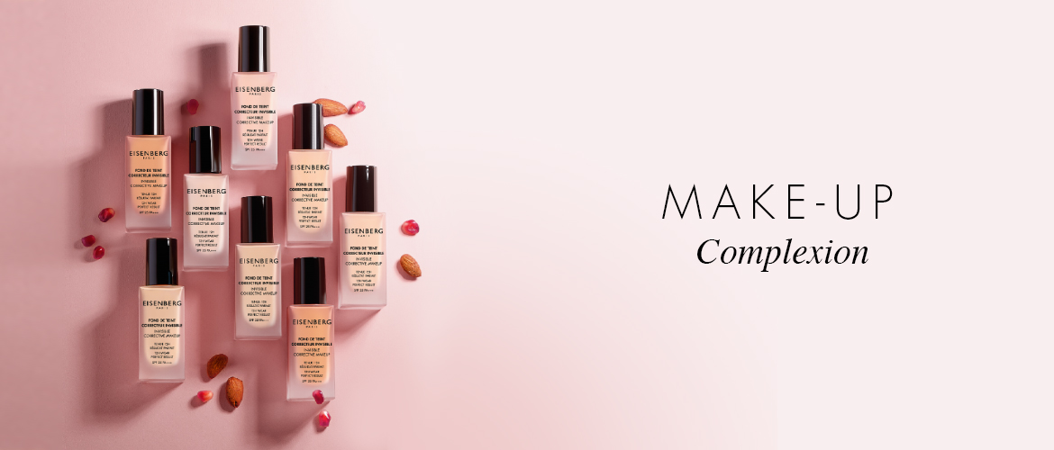 range of skin foundations with almond and pomegranate seeds on a bright pink background