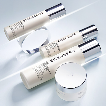 three dark spots corrector skincare and a white pot on a very light grey background
